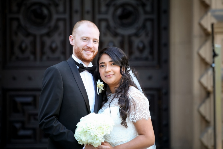 Bride and groom on the front steps at Beaumanor Hall Loughborough